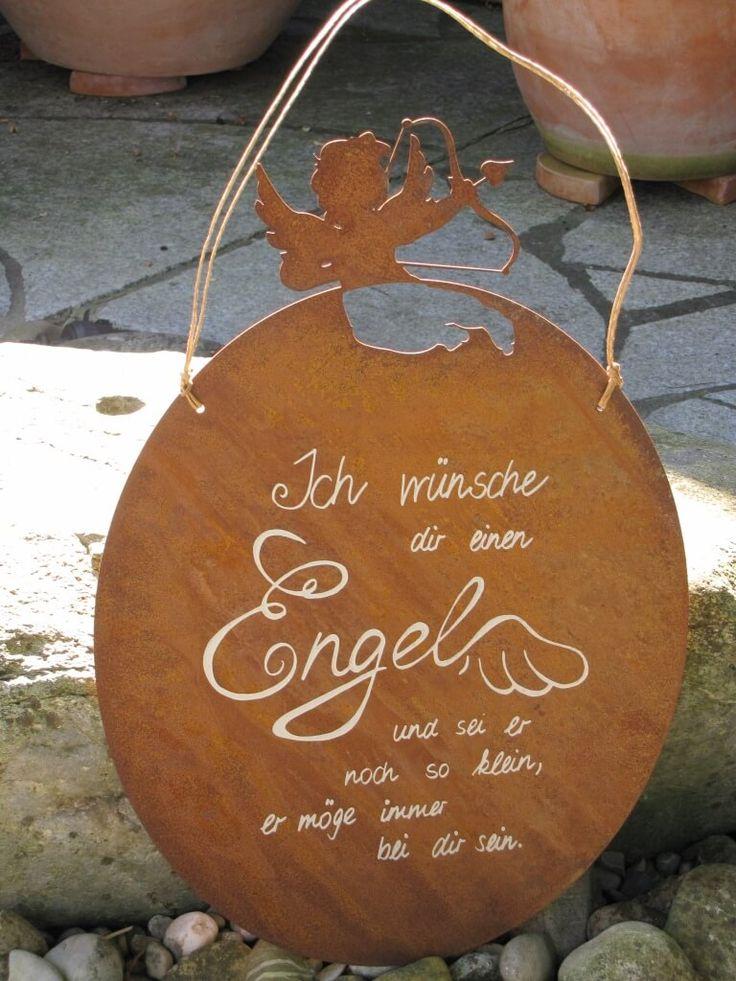 """Edelrost Gedichttafel Engel Amore  Das Edelrost Schild Amore Engel mit seinen kleine Schutzengel an der Oberseite ist eine Bereicherung für Haus und Garten. Das Schild kann mit dem bereits angebrachten Strick sofort aufgehängt werden.  Der Spruch auf dem Schild lautet:  """"Ich wünsche Dir einen Engel und sei er noch so klein, er möge immer bei Dir sein.""""  Maße:      Höhe: 48 cm     Breite: 20 cm  Preis: 24,- €"""