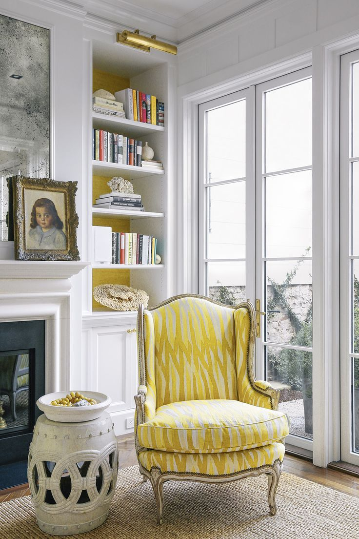 yellow chair and matching painted bookcase backs
