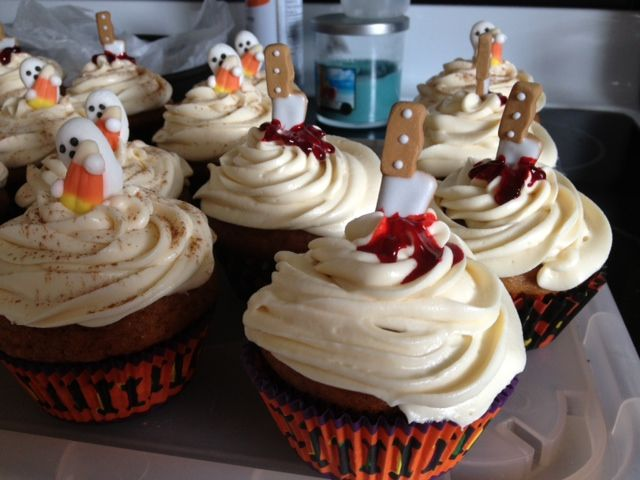 Made these cute little halloween cup cakes with my famous pumpkin spice cake recipe with my cream cheese icing. :-)
