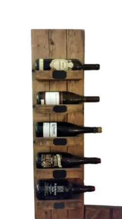 "This beautiful handmade wine rack will add a warm but rustic feel to any room This piece is finished with a walnut stain and hand distressed to give it the perfect rustic look. It measures 39"" high and 10.5"" wide and fits 5 standard wine bottles. Use the chalk labels on the shelf to personalize each bottle!Also available in a smaller, 3 shelf and 4 shelf option!Don't drink wine? It fits beer bottles! Please contact for more questions.Custom sizes and stains are available.Made to order."