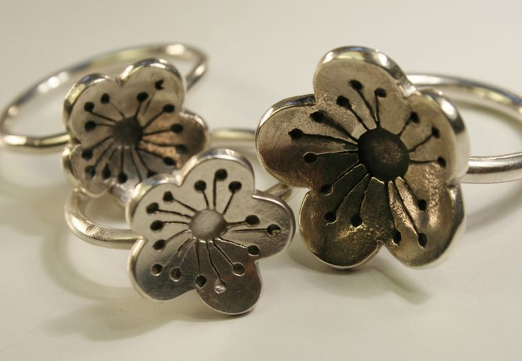 """cherry blossom "" sterling silver fabricated, oxidized. rings"