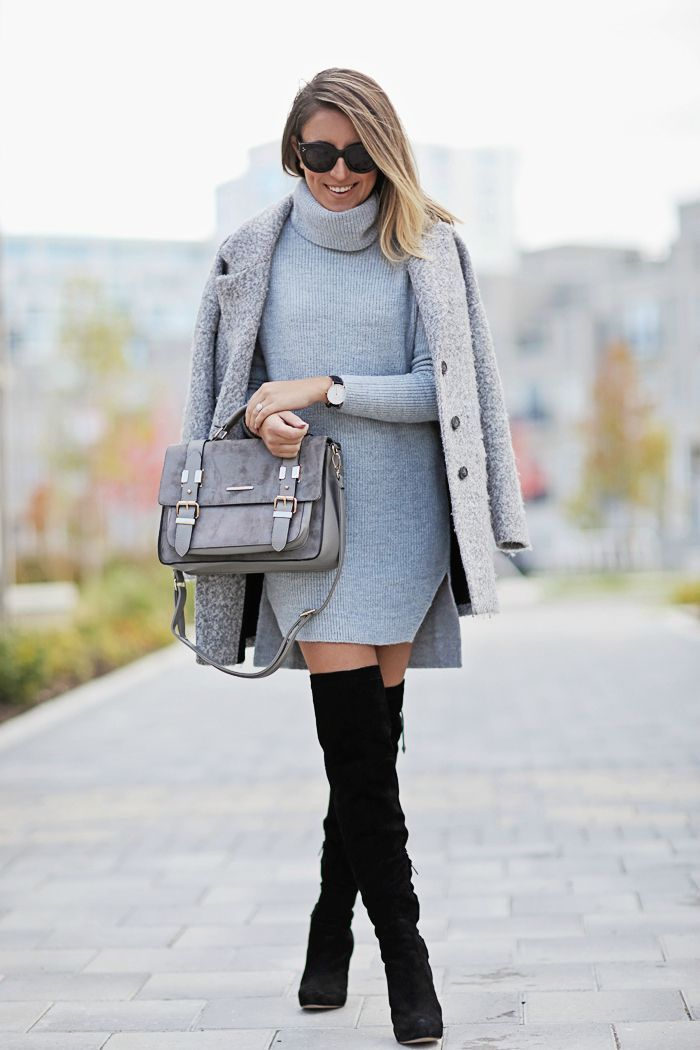 Stephanie Sterjovski wears a grey turtle neck sweater dress with black over the knee boots. Sweater Dress: River Island c/o, Boots: Sam Edelman.