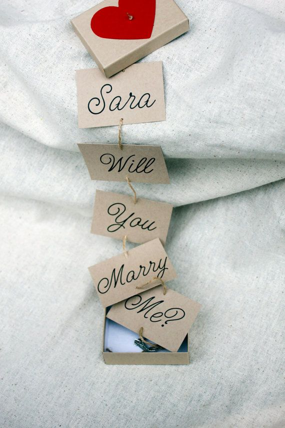 This rustic proposal ring box is the perfect way to ask Will you marry me? in a unique and memorable way. As the box is opened, the cards are pulled out to reveal the words Will You Marry Me? on each card. The very first card will be customized to include the name of your choice (please include that in the note to seller section when placing your order. If no note is left, the box will be sent without personalization) Each box measures 2in by 3inches and will come completely assembled. The…