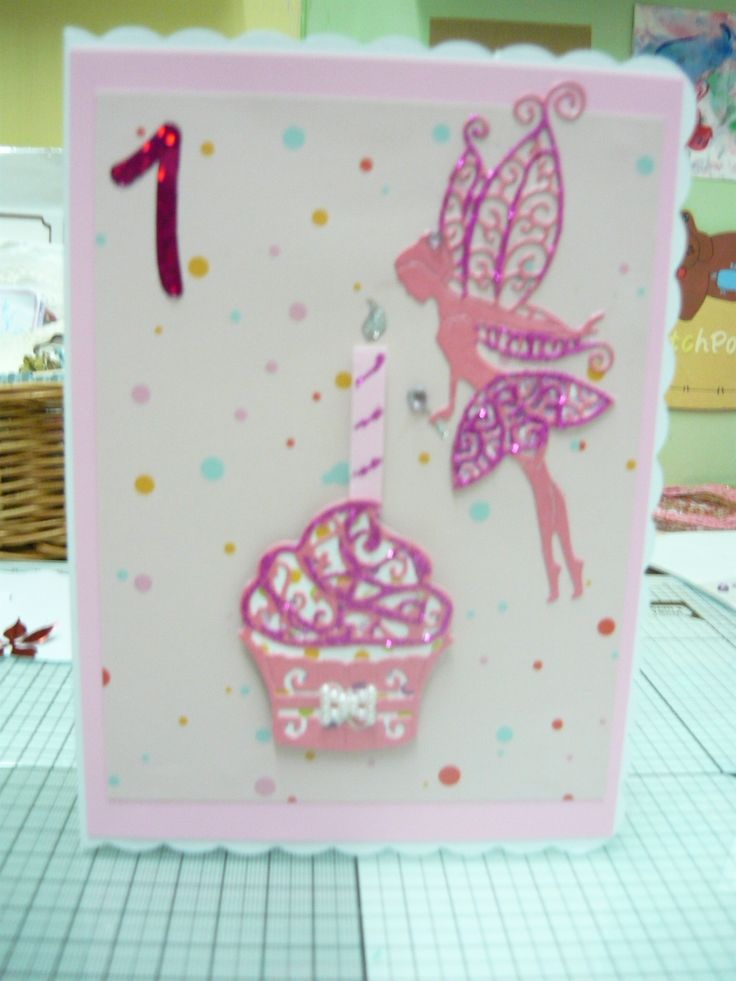 Birthday card for a 1year old , spotted backing paper with Tattered lace cupcake and fairy. Adding glitter and number to finish.