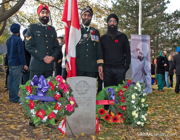 Lt.-Col. Harjit Singh Sajjan, Commanding Officer British Columbia Regiment (Duke of Connaught's Own), photographer Hartaarn Singh at the 2011 Sikh Remembrance Day Ceremony sponsored by SikhMuseum.com