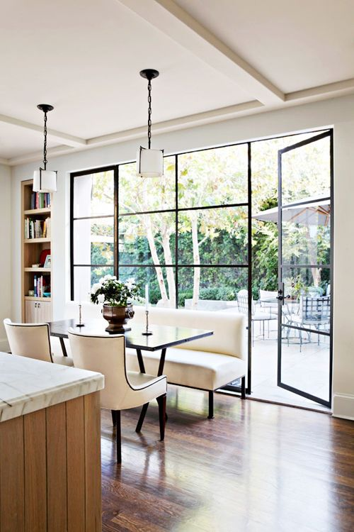floor to ceiling windows and door; dark edges frame the view. [Crush Cul de Sac]