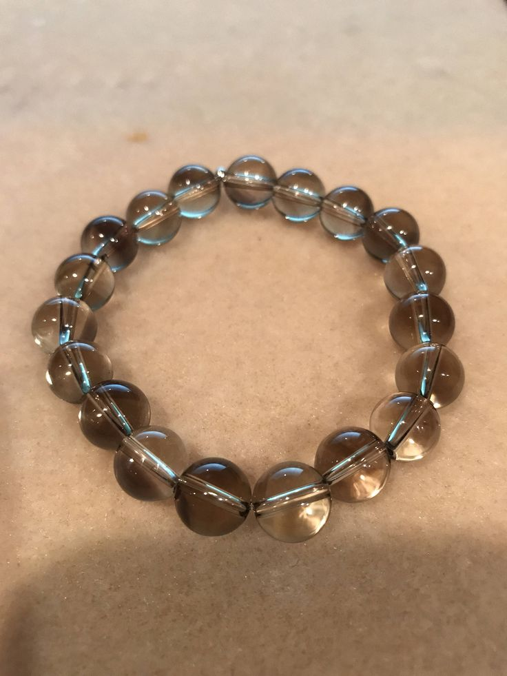 New in our shop! Smoky Lemon Quartz 10mm Round  Stretch Bead Bracelet with Sterling Silver Accent https://www.etsy.com/listing/525933493/smoky-lemon-quartz-10mm-round-stretch?utm_campaign=crowdfire&utm_content=crowdfire&utm_medium=social&utm_source=pinterest