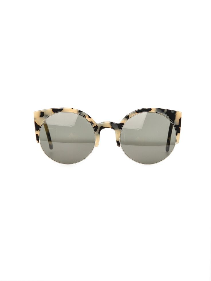 This black and white exaggerated tortoiseshell is perfection! Such striking cat eye sunglasses.