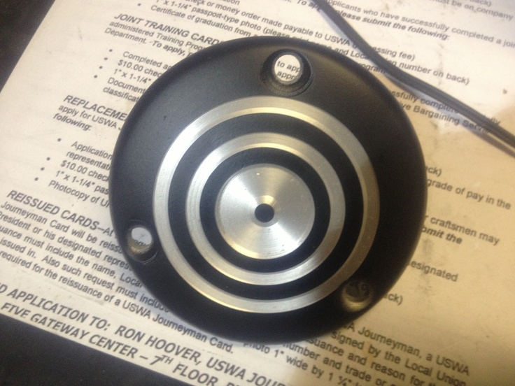This is a oil cover off a CB500t that I machined smooth, powder coated, then machined the design back out...