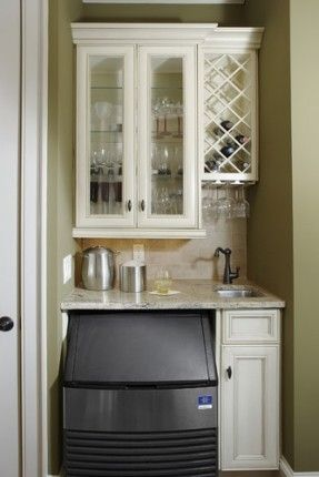 split of cabinet and wine rack no sink small fridge on bottom with or