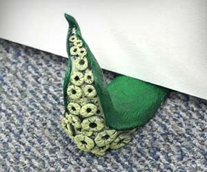 Keep your doors open while freaking out your house guests with these tentacle doorstops that look like a sea monster is creeping in from under the door. Perfect for any type of flooring and created by hand, each doorstop is unique in shape and color.
