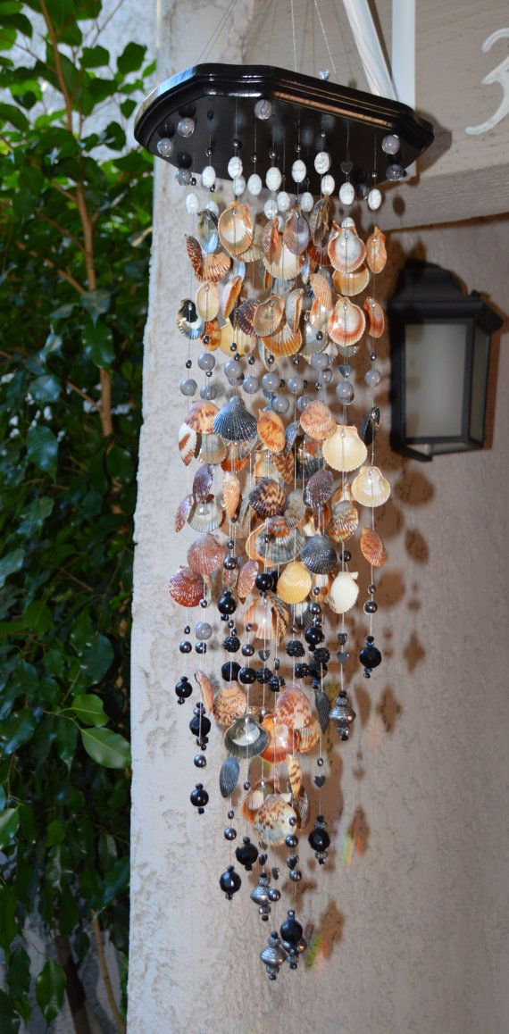 Wind chime made with seashells and glass beads. Black, grey and white glass beads/ stainless steel beads