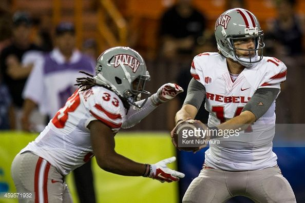 Jared Lebowitz hands the ball off to Shaquille MurrayLawrence of the UNLV Rebels during the second quarter of a college football game between the...