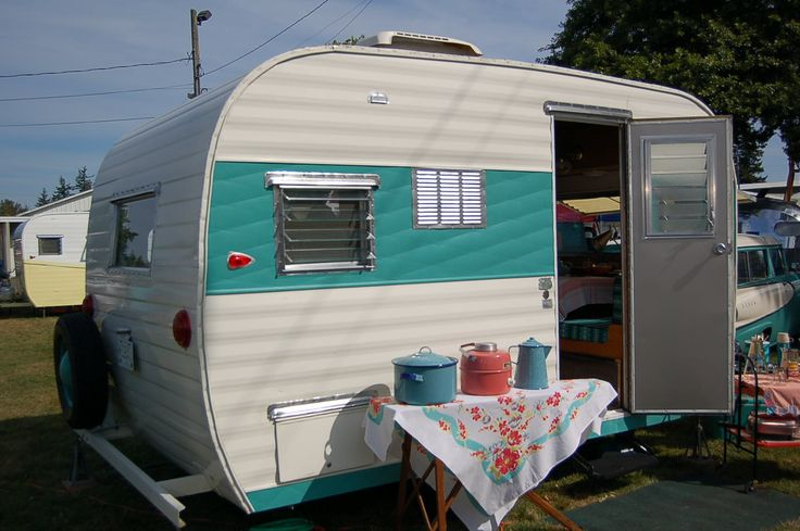 I think I like this pale teal color better than true turquoise.  http://oldtrailer.com/Images/1965-aloha-trailer-802.jpg