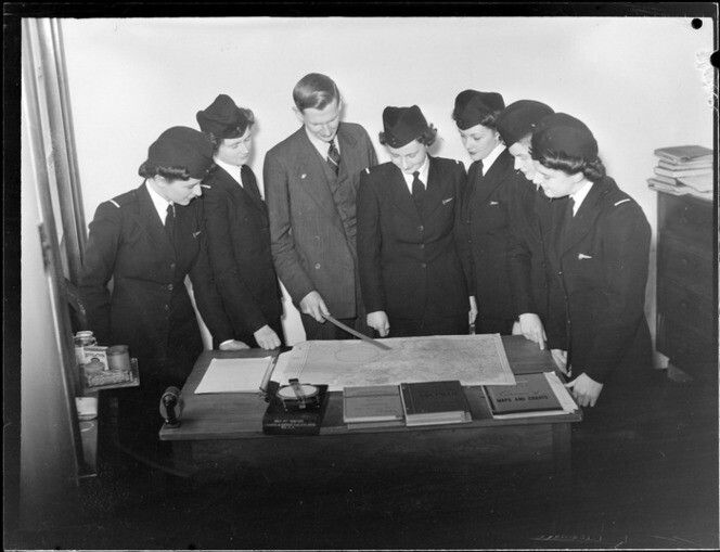 TEAL Tasman Empire Airways stewardesses, studying flight chart. Date: Aug 1946. Photograph taken by Whites Aviation.