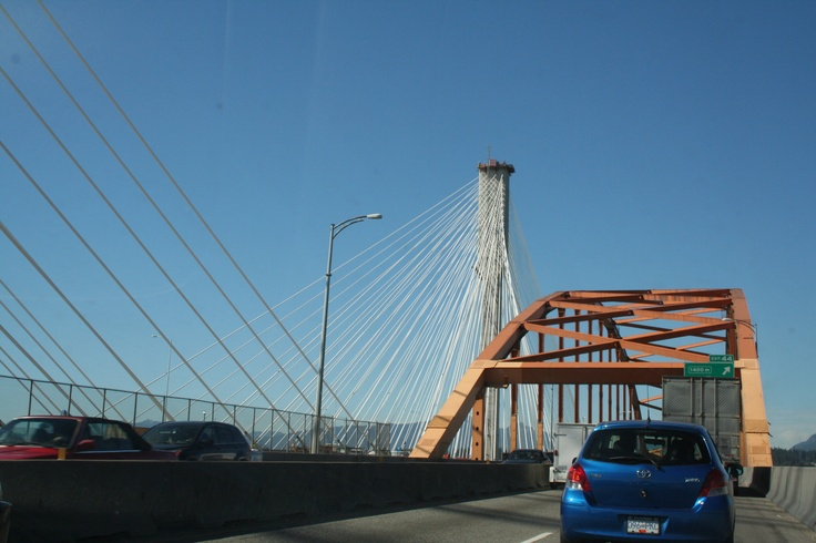Northbound on the original Port Mann Bridge, entering the steel arch. The north pillar of the new superbridge is at the left.