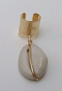 Brass Cowrie Shell Ear Cuff Natural Hair Accessories DreadLock Jewelry. $15.00, via Etsy.