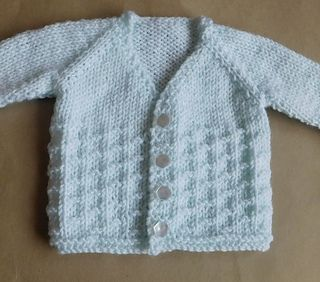 This is a lovely little V-neck baby cardigan