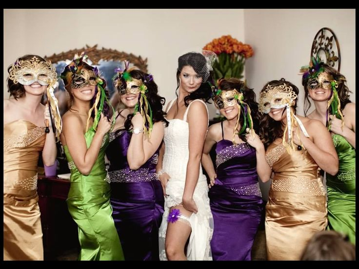 Bride and bridesmaids before the Mardi Gras themed wedding having a fun pose JHicks photo