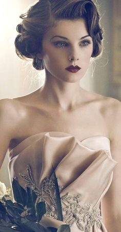 Vintage is definitely in! Such gorgeous hair and makeup, perfect for my wedding! Maybe a burgundy lip instead!