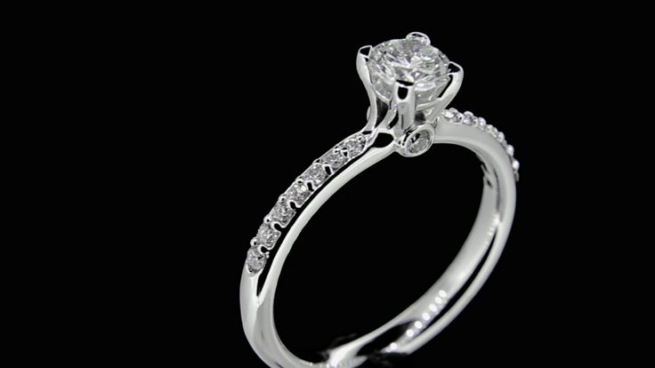 'BECKY' -- Custom Made Solitaire set with Brilliant Cut Diamond in 18ct White Gold with Accent set Diamond shoulders. Dia.Wt. 0.70 carat - G/Si.