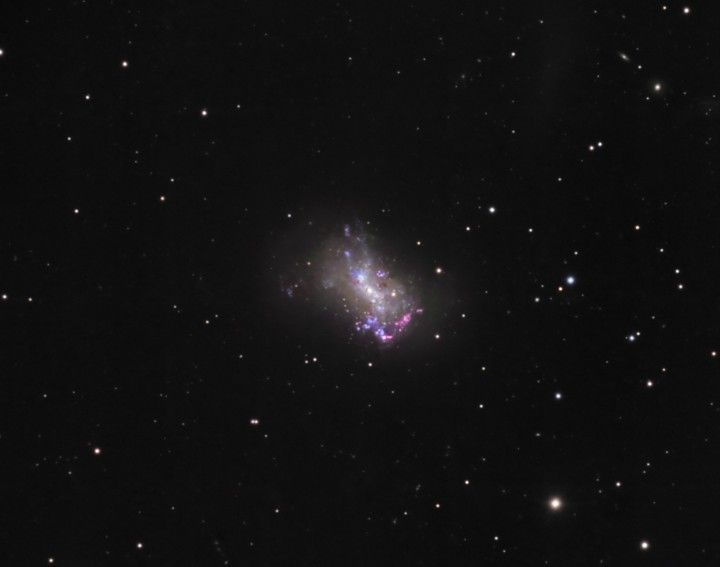 Small Galaxy NGC 4449: is an irregular galaxy in the constellation Canes Venatici. It is located about 12 million light-years away, part of the M94 Group (the Canes Venatici I Group), a galaxy group relatively close to the Local Group containing the Milky Way.