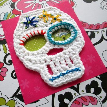 Celebrate the Day of the Dead with crochet sugar skulls embellished with bright embroidery floss - fun!