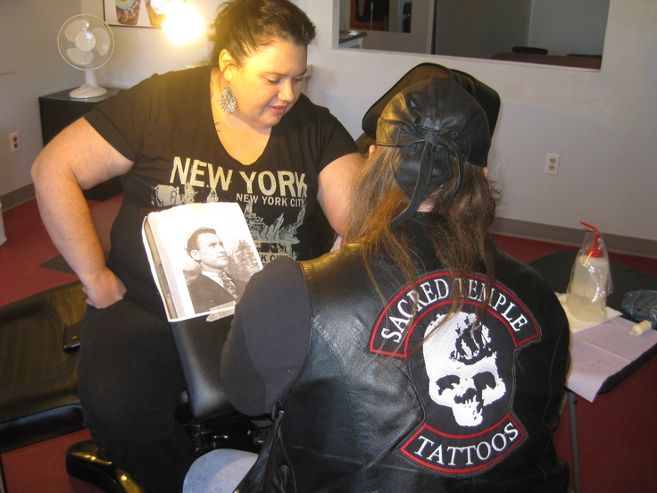 Candy getting her daddy tattooed on her arm by Jamie Mackay