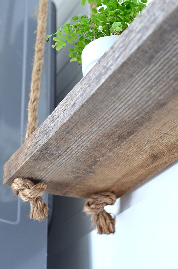 A finished DIY hanging rope shelf project