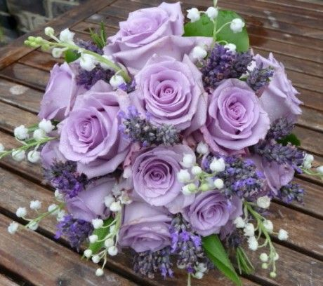 Wedding bouquet of lilac 'Ocean Song' roses teamed with scented lily of the…