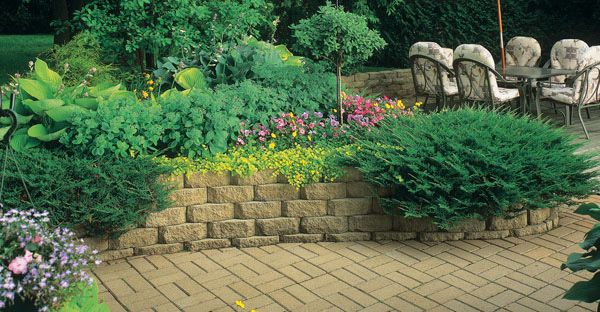 how to build a retaining wall with landscape blocks...materials list, tools list and step by step directions