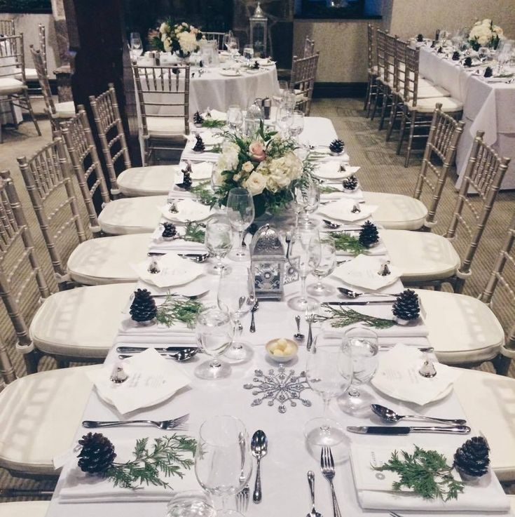 Table setting and floral centrepiece at a Winter Wonderland wedding #AncasterMill
