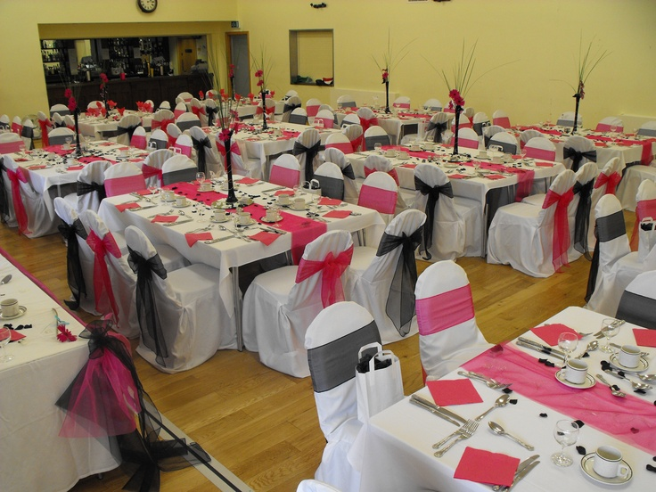 Alternating Black and Fuschia Pink Organza Bows on White Chair Covers