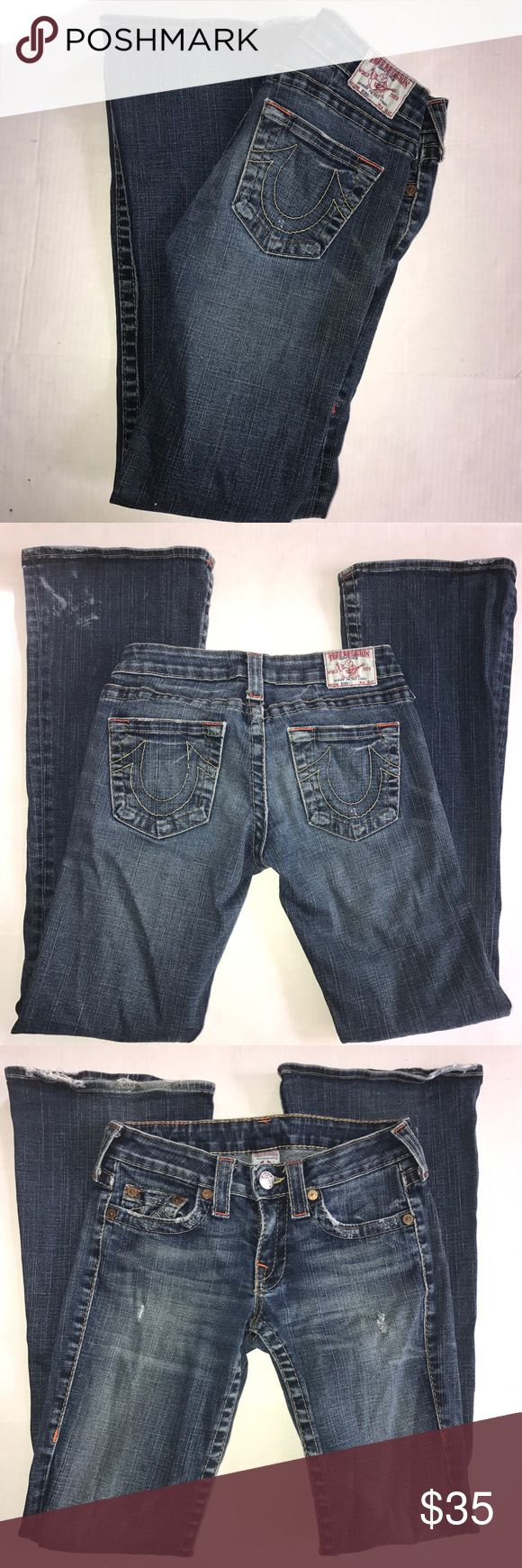 """Authentic True Religion 28"""" women's bootcut jeans Authentic True Religion bootcut denim blue jeans. Women's size 28"""". Inseam is 31"""". Distressed denim, with horseshoe embroidered pockets. In very good condition, there is a white mark at bottom of back of Jean cuff, and some Norma wear on very bottom hem. Clean and comes from smoke and pet free  home. True Religion Jeans Boot Cut"""