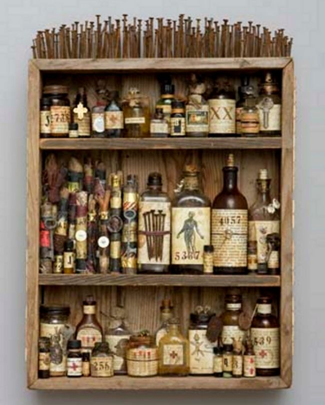 """It's just an art project, but it's still lovely.  """"Medicine Cabinet, Mar Goman.  Wooden box, altered bottles, found objects, scrolls, nails, mixed media, 2009.  24 x 17 x 5"""""""