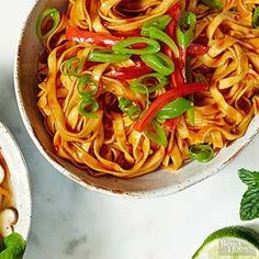 This spicy noodle bowl gets heat from sambal oelek chili paste. /