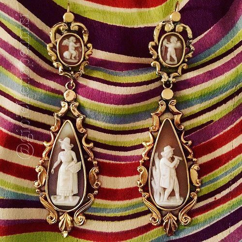 A pair of 19th century gold and shell cameo earrings.