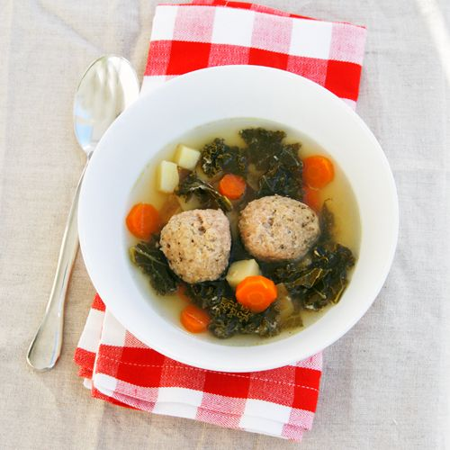 Slow cooker chicken meatball soup with kale and other vegetables.  Definitely will be making this week!