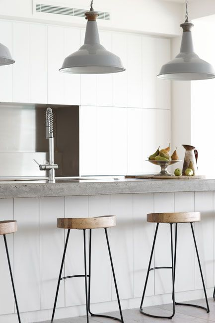 wood stools + grey metal pendants + concrete counter - kitchen styling