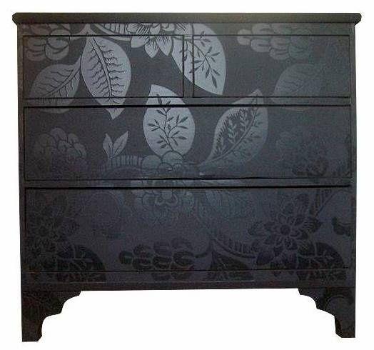 Spray painted dresser - gloss paint stenciled over matte