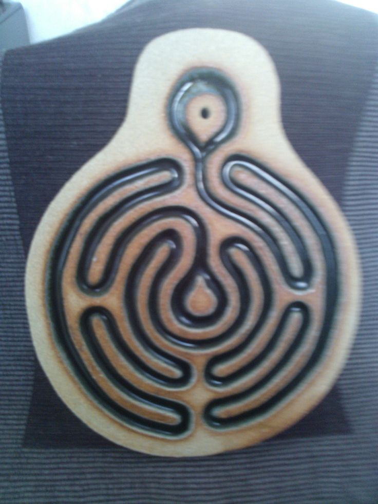 Ceramic pottery and crushed bottle glass to make a calming finger labyrinth.  1/2 thick slab of clay. Carve out any pattern you like, Smooth the edges. Bisque fire. Fill ditches with crushed wine bottle glass and refire. Crackles will appear in light colored glass. This one was a Black Tower wine bottle.