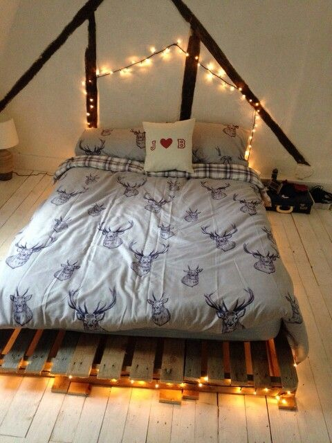 Pallet bed with fairy lights