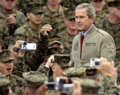 President George W Bush...WHENS THE LAST TIME....HE, (not bush) visited any of our troops, hospital or any pic with our service people??????