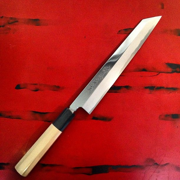 SUISIN HAYATE LIGHT KIRITSUKE. The Hayate line is a special knife created exclusively by Master Blacksmith Keijiro Doi for the Suisin Knife Company. In forging, Master Doi joins a large ao-ko steel billet with the soft iron body of this yanagi knife at the lowest temperature possible, resulting in the Hayate's superior blade strength and edge life. Kiritsuke style is the only multipurpose traditional Japanese knife, in Japan only the executive chef in the kitchen is allowed to own one in…