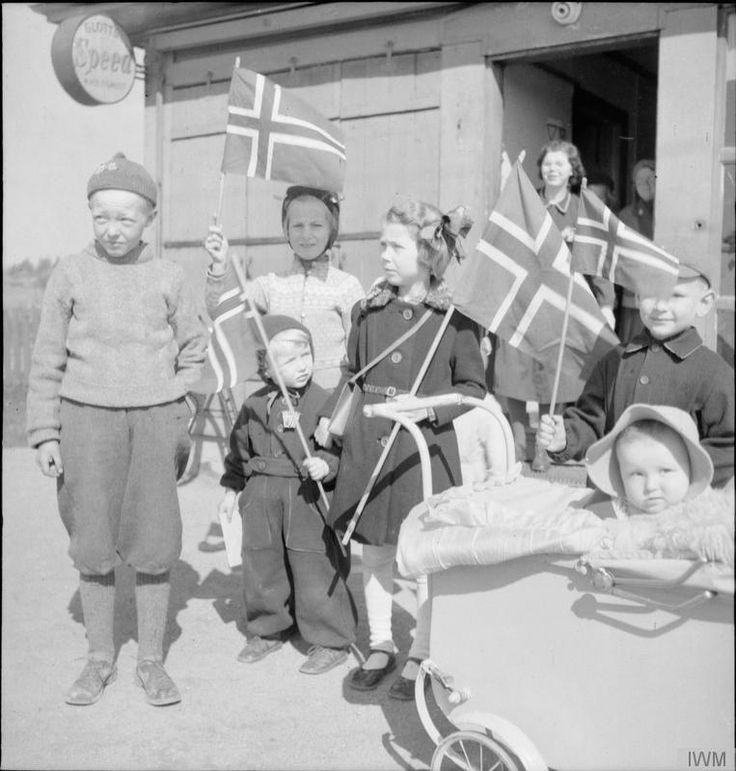 May 1945. Norwegian children welcomes British troops arrived at Gardermoen airfield near Oslo.