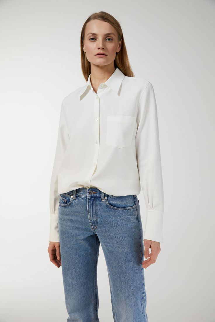 Cut from a viscose cotton twill fabric with a silky feel, this long-sleeve blouse is comfortably lightweight. With a pleasant, drapy finish, this is an eas