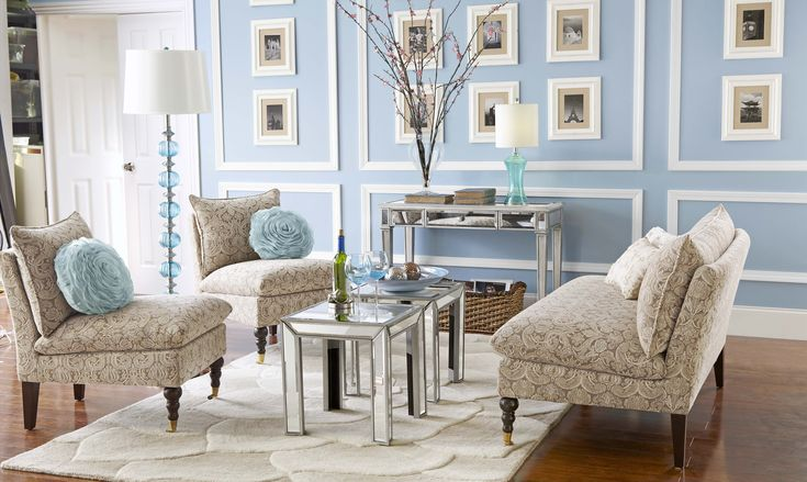 Pier 1 Hayworth Living Room. I love how the pillows and lamps match the wall color. I'd just prefer a deeper blue.