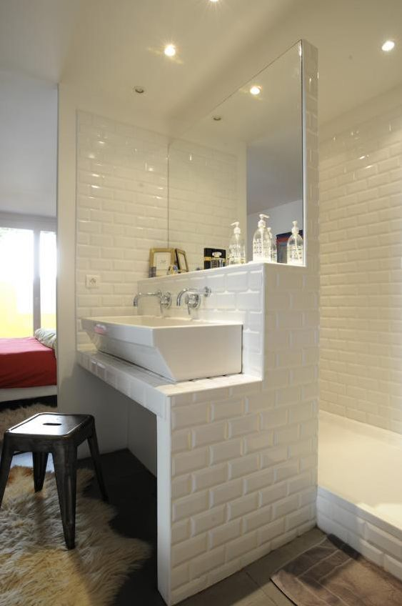 ensuite bathroom with brick shaped white tiles home
