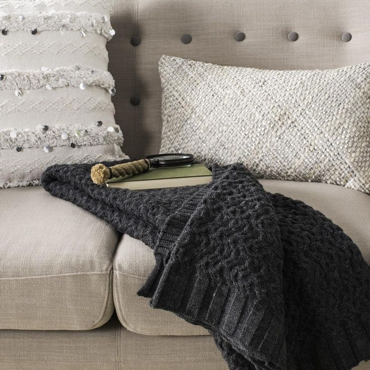 Bring the luxury of cable knit blankets to bedroom and living room décor with the Affinity Knit Throw. Supple, dark grey cotton yarns are woven into a thic