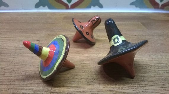 Ceramic spinning tops from brown clay. Sombrero, Spaceship, Witch hat